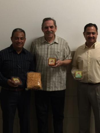Image of Mike and Armando Pina from Vista Markets with Dr. Fedio